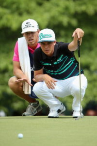 PINEHURST, NC - JUNE 13: Rickie Fowler of the United States and caddie Joseph Skovron line up a putt on the sixth hole during the second round of the 114th U.S. Open at Pinehurst Resort & Country Club, Course No. 2 on June 13, 2014 in Pinehurst, North Carolina. (Photo by Andrew Redington/Getty Images)