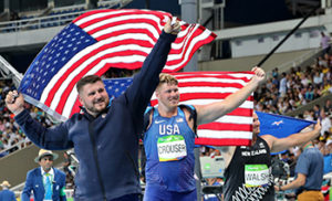 From left, silver medalist for the men's shot put United States' Joe Kovacs, gold medallist and compatriot Ryan Crouser and New Zealand's Tomas Walsh, bronze, celebrate with their national flags during the athletics competitions of the 2016 Summer Olympics at the Olympic stadium in Rio de Janeiro, Brazil, Thursday, Aug. 18, 2016. (AP Photo/Lee Jin-man)